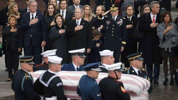 PHOTO: The Bush family looks on as a joint military services honor guard carries the casket for former President George H.W. Bush from the Union Pacific funeral train at Texas A&M University in College Station, Texas, Dec. 6, 2018. (Loren Elliott/Reuters)