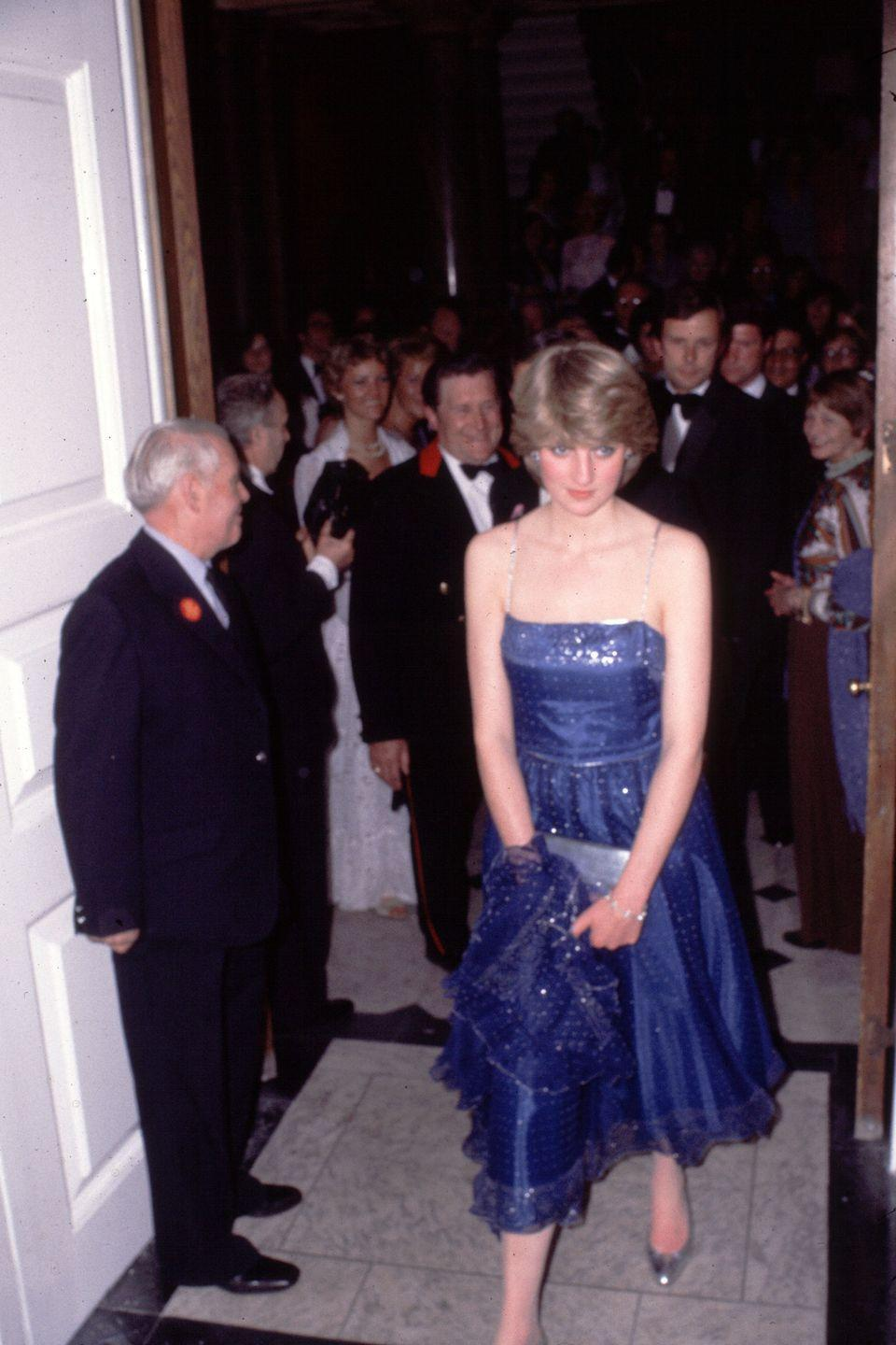 <p>At the Royal Academy in a blue sequin dress. </p>