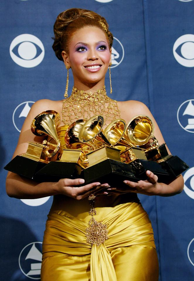 Singer Beyonce Knowles poses with her six Grammys backstage in the Pressroom at the 46th Annual Grammy Awards held at the Staples Center on February 8, 2004 in Los Angeles, California.  (Photo by  Frederick M. Brown/Getty Images)