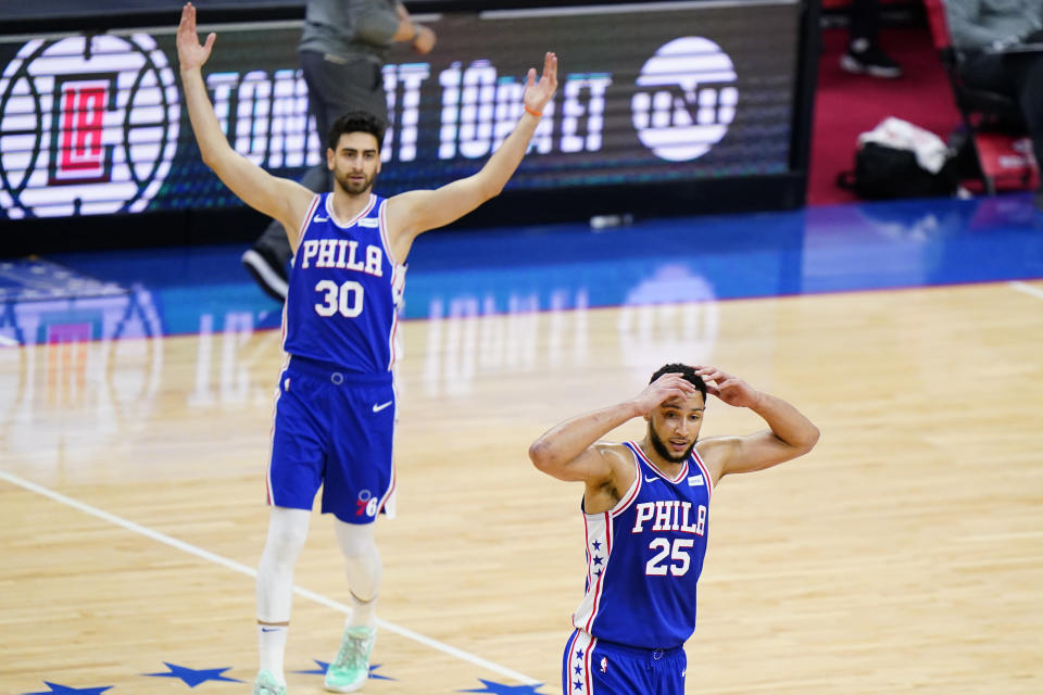 Philadelphia 76ers' Ben Simmons (25) and Furkan Korkmaz (30) react after a foul call during the first half of Game 5 in a first-round NBA basketball playoff series against the Washington Wizards, Wednesday, June 2, 2021, in Philadelphia. Ben Simmons can't shoot and lost his confidence. He blamed a mental block on the worst free-throw shooting percentage in NBA playoff history. The 76ers head into the offseason faced with a big question - do they try and salvage Simmons or deal the former No. 1 pick. (AP Photo/Matt Slocum)