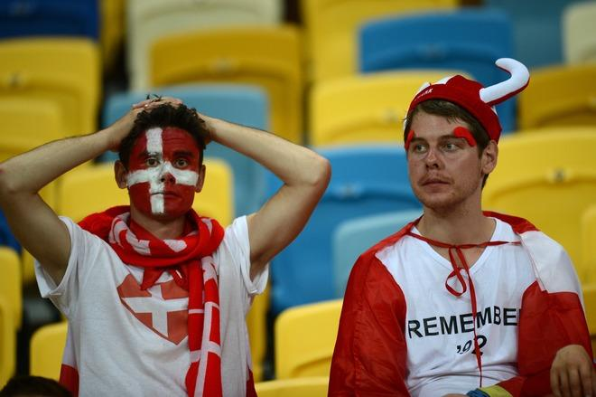 Danish supporters react at the end of the Euro 2012 football championships match Denmark vs. Germany, on June 17, 2012 at the Arena Lviv in Lviv.  Germany won 2-1. Denmark is out of the competition.  AFP PHOTO / JEFF PACHOUDJEFF PACHOUD/AFP/GettyImages