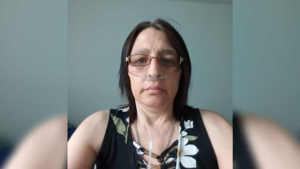Wanda McCarthy of Grand Falls says she's eligible to undergo a double lung transplant but hasn't been able to find someone willing to act as her support provider. (Submitted by Wanda McCarthy - image credit)