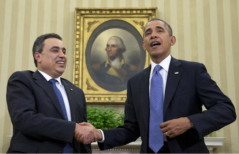 President Barack Obama and Tunisian Prime Minister Mehdi Jomaa shakes hands after speaking to the media, Friday, April 4, 2014, in the Oval Office of the White House in Washington. (AP Photo/Carolyn Kaster)