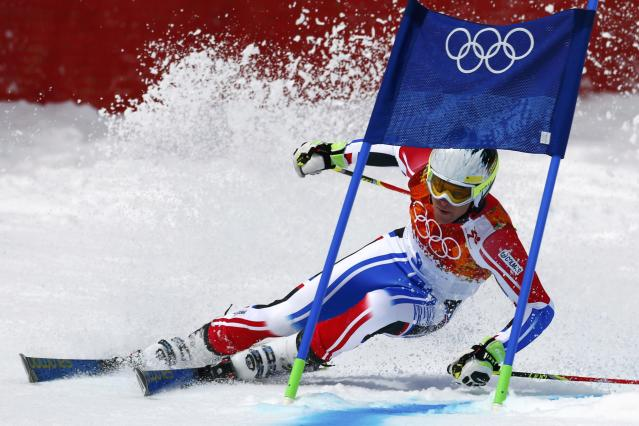 France's Alexis Pinturault clears a gate during the first run of the men's alpine skiing giant slalom event at the 2014 Sochi Winter Olympics at the Rosa Khutor Alpine Center February 19, 2014. REUTERS/Dominic Ebenbichler (RUSSIA - Tags: SPORT SKIING OLYMPICS)