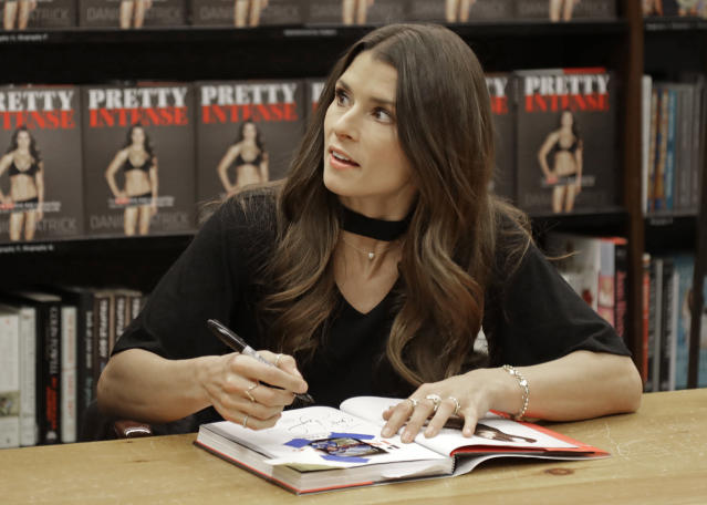 "<a class=""link rapid-noclick-resp"" href=""/nascar/nationwide/drivers/1311"" data-ylk=""slk:Danica Patrick"">Danica Patrick</a> talks to a fan as she autographs her new book during a book signing in Charlotte, N.C., Thursday, Jan. 4, 2018. The transition from race car driver to businesswoman was swift, and Patrick is now adjusting to a new celebrity life that doesnt include driving cars. (AP Photo/Chuck Burton)"