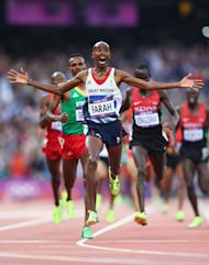 Mohamed Farah crosses the finish line to win gold in the Men's 5000m Final (Getty Images)