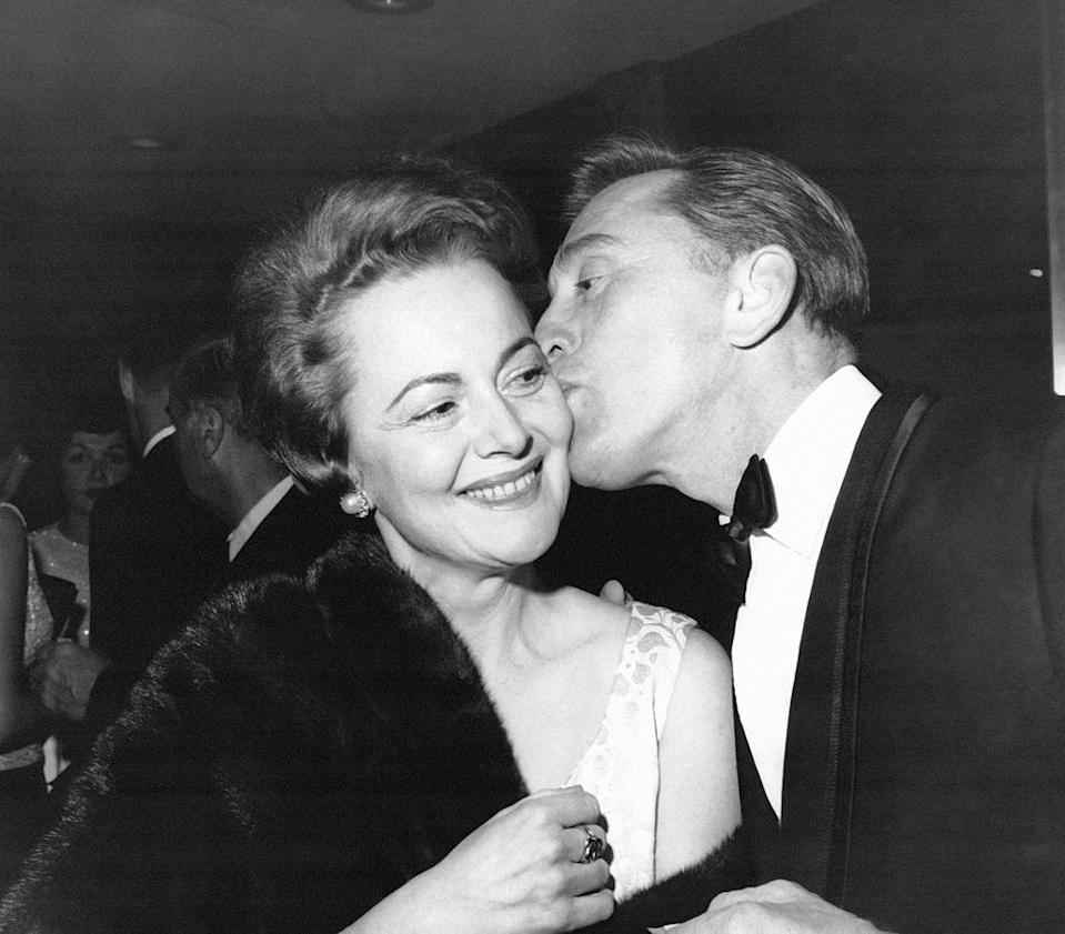 <p>Olivia receiving a kiss on the cheek from Kirk Douglas.</p>