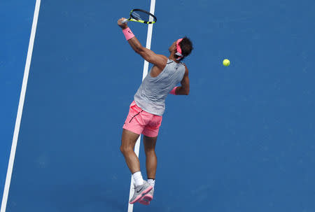 Tennis - Australian Open - Rod Laver Arena, Melbourne, Australia, January 21, 2018. Rafael Nadal of Spain jumps and turns to the baseline to hit a backhand shot against Diego Schwartzman of Argentina. REUTERS/Edgar Su