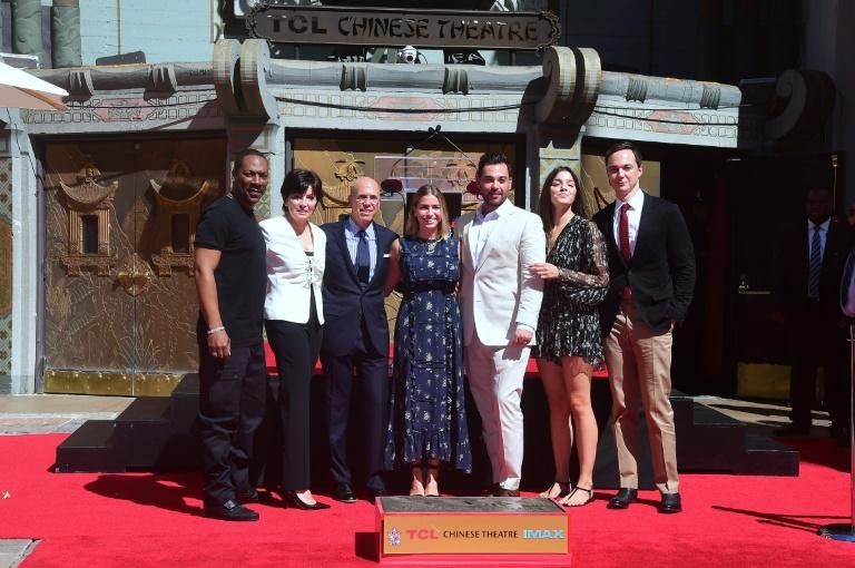 Hollywood producer Jeffrey Katzenberg(3rdL) is joined by actors Eddie Murphy(L) and Jim Parsons(R) while posing with his family at his Hand and Footprints ceremony in front of the TCL Chinese Theater