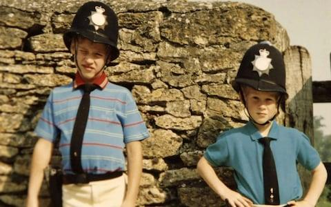 Prince William and Prince Harry in borrowed policemen outfits - Credit: PA