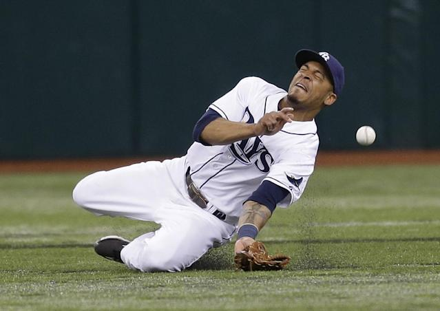 Tampa Bay Rays center fielder Desmond Jennings dives but can't come up with a fifth-inning double by Texas Rangers' Mitch Moreland during a baseball game Monday, Sept. 16, 2013, in St. Petersburg, Fla. (AP Photo/Chris O'Meara)