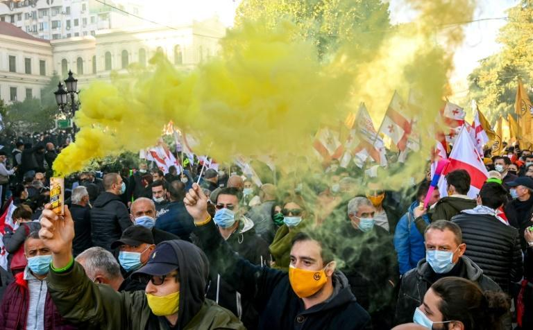 Thousands of Georgian opposition supporters rallied on Sunday against a ruling party accused of rigging legislative elections that it won narrowly a week ago.