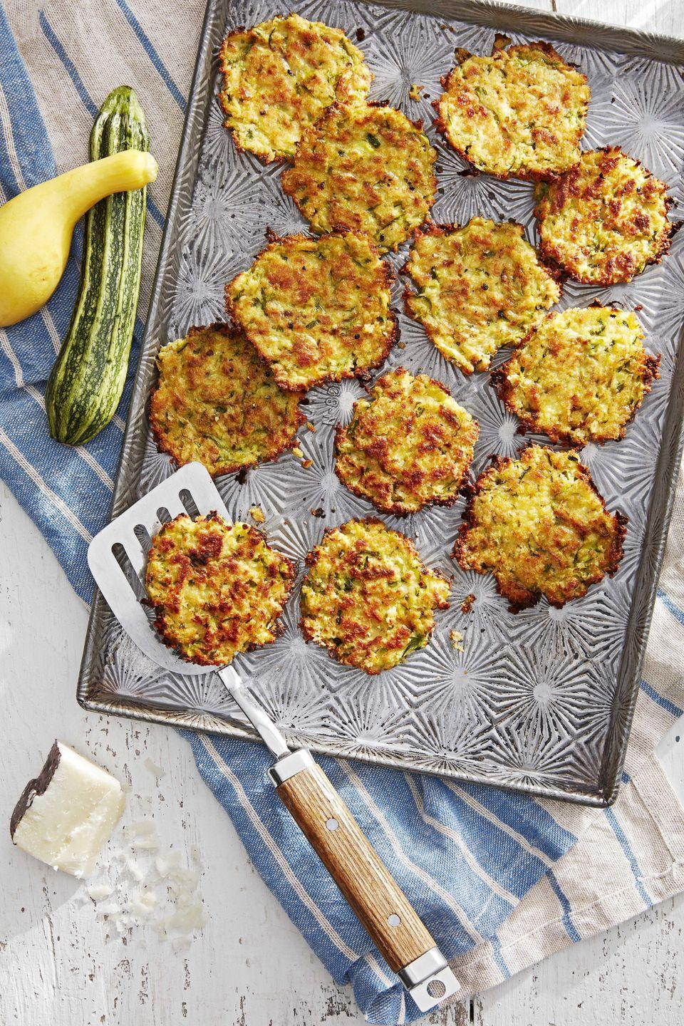 """<p>These oven baked fritters, chock-full of grated zucchini and Pecorino cheese, make a perfect barbecue starter.</p><p><strong><a href=""""https://www.countryliving.com/food-drinks/a28610429/zucchini-and-pecorino-fritters-recipe/"""" rel=""""nofollow noopener"""" target=""""_blank"""" data-ylk=""""slk:Get the recipe"""" class=""""link rapid-noclick-resp"""">Get the recipe</a>.</strong></p>"""