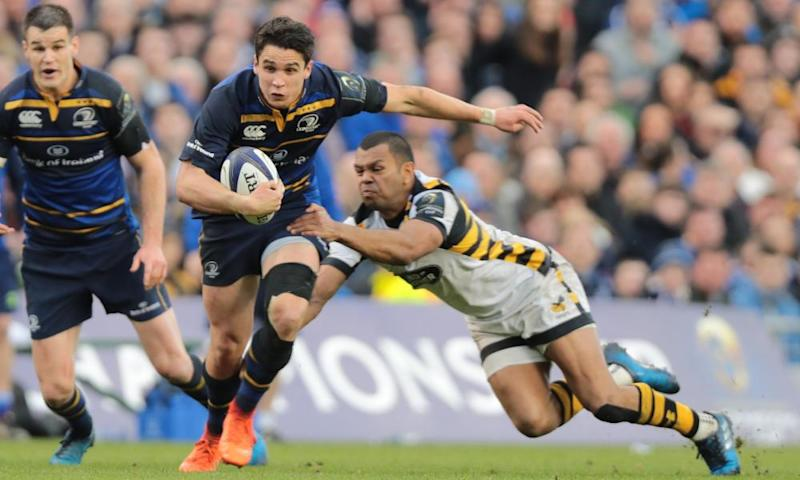 Leinster's Joey Carbery goes past Kurtley Beale, of Wasps, during the European Rugby Champions Cup quarter-final at the Aviva Stadium.