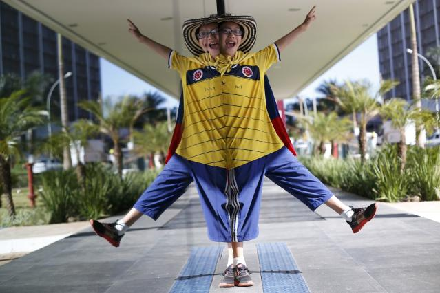 A supporter of Colombia's national soccer team poses for a picture before their 2014 World Cup Group C soccer match against the Ivory Coast at the Mane Garrincha National Stadium in Brasilia, June 19, 2014. REUTERS/Ueslei Marcelino (BRAZIL - Tags: SOCCER SPORT WORLD CUP)