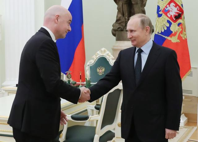 Russian President Vladimir Putin, right, greets FIFA president Gianni Infantino during their meeting in the Kremlin in Moscow, Russia, Monday, Feb. 12, 2018. (Mikhail Klimentyev/Pool Photo via AP)
