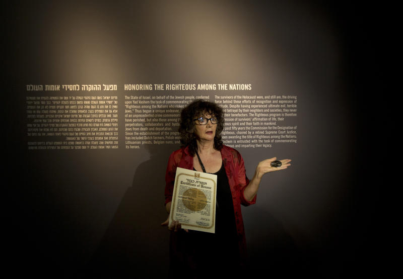 "Irena Steinfeldt, an official at Israel's Yad Vashem Holocaust memorial, holds a certificate recognizing Mohamed Helmy, an Egyptian physician in Berlin, as ""Righteous Among the Nations"" for saving a Jewish family during the Holocaust, in Jerusalem, Monday, Sept. 30, 2013. Israel's Holocaust memorial said it is posthumously honoring the Egyptian doctor who risked his life to rescue Jews during World War II, the first Arab ever to receive the prestigious award. (AP Photo/Sebastian Scheiner)"