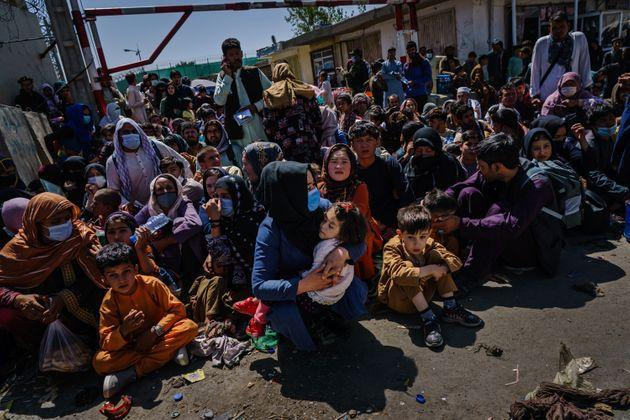 Women and children are made to crouch and wait outside the Taliban controlled check point near the airport's Abbey Gate, in Kabul, Afghanistan, Wednesday, Aug. 25, 2021 (Photo: Marcus Yam via Getty Images)