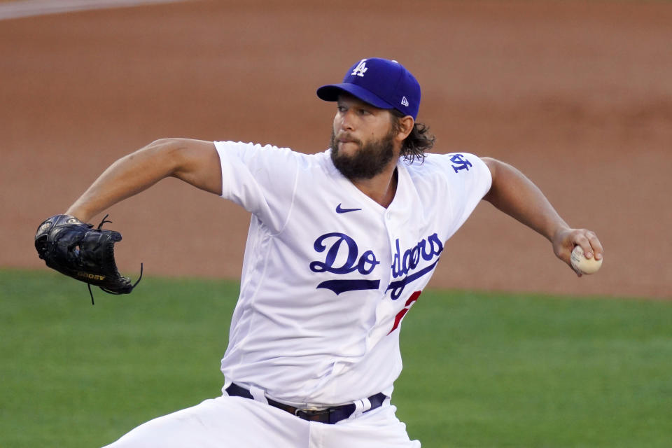 Los Angeles Dodgers starting pitcher Clayton Kershaw winds up during the first inning of the team's baseball game against the San Francisco Giants on Saturday, Aug. 8, 2020, in Los Angeles. (AP Photo/Mark J. Terrill)