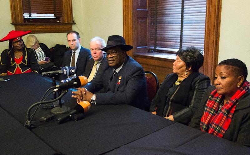 Herero chief Vekuii Rukoro (C) speaks during a news conference while other members of the delegation listen on March 16, 2017 in New York (AFP Photo/DON EMMERT)