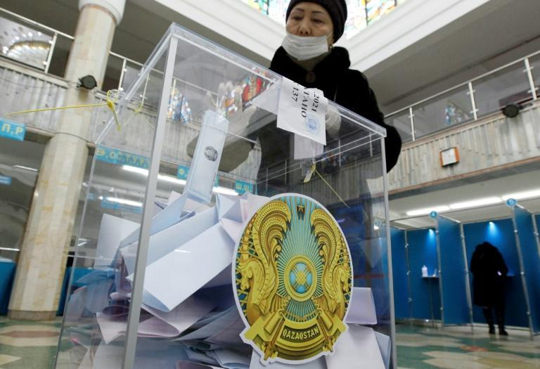 A woman votes during Kazakhstan's parliamentary election in Nur-Sultan on January 10, 2021.