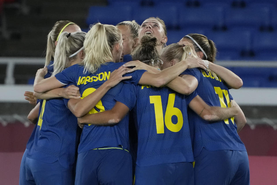 Sweden players celebrate after Fridolina Rolfo scoring her side's opening goal against Australia during a women's semifinal soccer match at the 2020 Summer Olympics, Monday, Aug. 2, 2021, in Yokohama, Japan. (AP Photo/Kiichiro Sato)