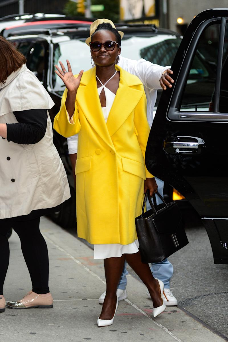 Lupita Nyong'o in an Escada coat at The Late Show with Stephen Colbert, September 2016.