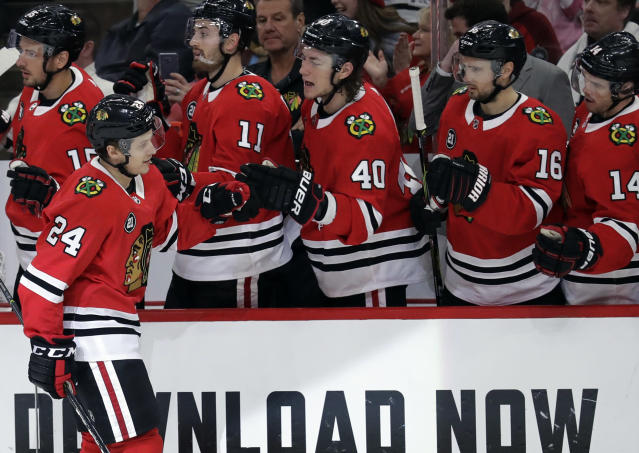 Chicago Blackhawks center Dominik Kahun (24) celebrates with teammates after scoring a goal during the first period of an NHL hockey game against the Detroit Red Wings, Sunday, Feb. 10, 2019, in Chicago. (AP Photo/Nam Y. Huh)