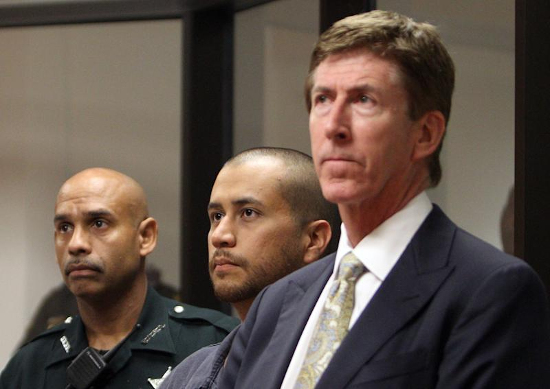 George Zimmerman, center, stands with his attorney Mark O'Mara, right, and a Seminole County Deputy during a court hearing Thursday April 12, 2012, in Sanford, Fla. Zimmerman has been charged with second-degree murder in the shooting death of the 17-year-old Trayvon Martin. (AP Photo/Gary W. Green, Orlando Sentinel, Pool)