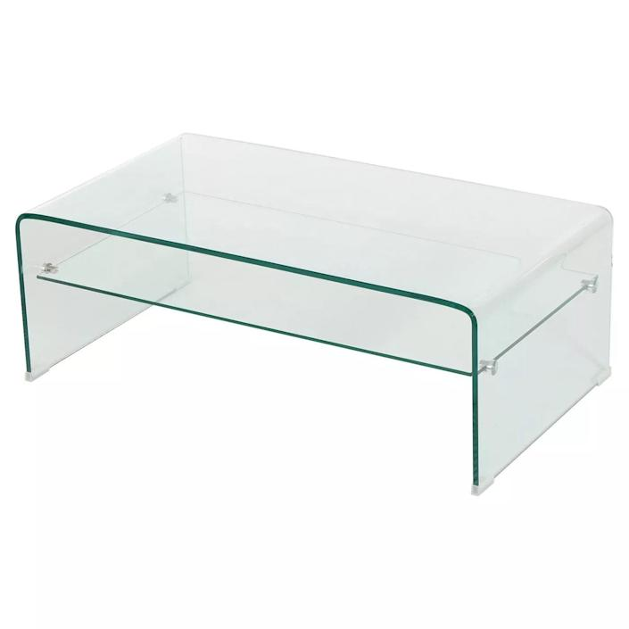 """$232, Target. <a href=""""https://www.target.com/p/ramona-glass-rectangle-coffee-table-w-shelf-clear-christopher-knight-home/-/A-51305389"""" rel=""""nofollow noopener"""" target=""""_blank"""" data-ylk=""""slk:Get it now!"""" class=""""link rapid-noclick-resp"""">Get it now!</a>"""