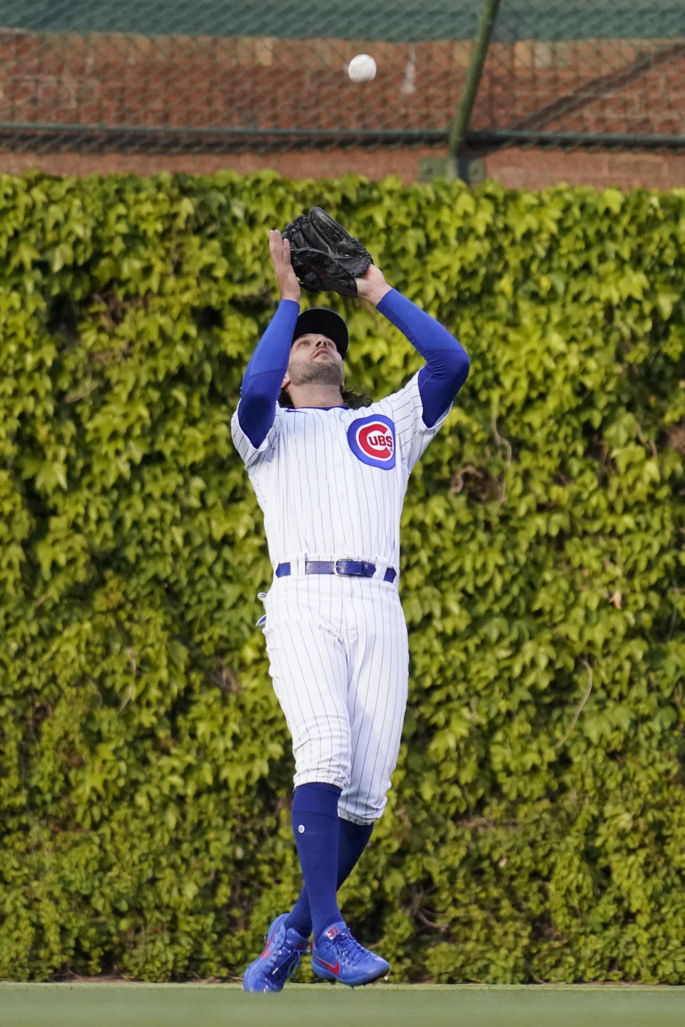 Chicago Cubs center fielder Jake Marisnick catches a fly ball by Los Angeles Dodgers' Corey Seager during the first inning of a baseball game in Chicago, Wednesday, May 5, 2021. (AP Photo/Nam Y. Huh)