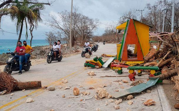 PHOTO: Motorcyclists pass debris on the road after the passing of Hurricane Iota on San Andres Island, Colombia, Nov. 17, 2020. (Christian Quimbay/AP)