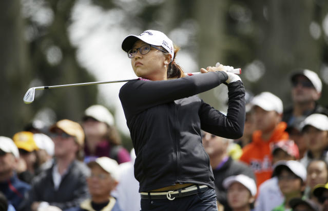 Lydia Ko, of New Zealand, follows her shot from the third tee of the Lake Merced Golf Club during the final round of the Swinging Skirts LPGA Classic golf tournament on Sunday, April 27, 2014, in Daly City, Calif. (AP Photo/Eric Risberg)