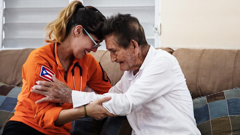 Gil Feliciano says goodbye to one of the doctors from Iniciativas De Paz that came to check on him and his wife.