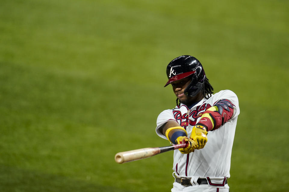 ARLINGTON, TX - OCTOBER 16:  Ronald Acuna Jr. #13 of the Atlanta Braves swings a bat while on-deck in the first inning during Game 5 of the NLCS between the Atlanta Braves and the Los Angeles Dodgers at Globe Life Field on Friday, October 16, 2020 in Arlington, Texas. (Photo by Cooper Neill/MLB Photos via Getty Images)