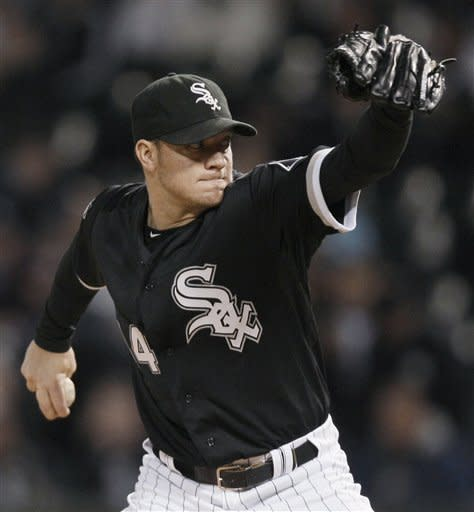 Chicago White Sox starter Jake Peavy throws to a Tampa Bay Rays batter during the first inning of a baseball game in Chicago, Thursday, Sept. 27, 2012. (AP Photo/Nam Y. Huh)