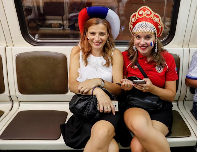 People ride the metro after the World Cup final soccer match in Moscow, Russia July 15, 2018. As well as shooting all the matches, Reuters photographers are producing pictures showing their own quirky view from the sidelines of the World Cup. REUTERS/Gleb Garanich