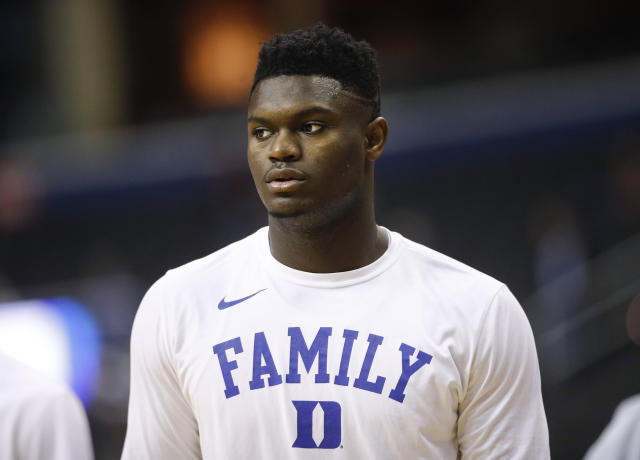 FILE - In this March 31, 2019, file photo, Duke forward Zion Williamson warms up before the start of an NCAA men's East Regional final college basketball game against Michigan State, in Washington. The player widely projected to be the NBA drafts top overall pick came up at a college basketball corruption trial as jurors heard a recording of a Clemson coach who seemed eager for help recruiting him. The charismatic Zion Williamson played one year at Duke before entering the draft scheduled for June. (AP Photo/Patrick Semansky, File)