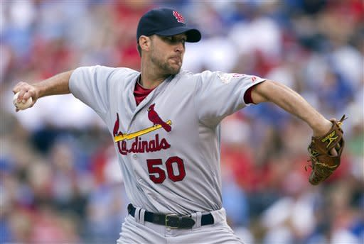 St. Louis Cardinals starter Adam Wainwright pitches to Kansas City Royals' Alex Gordon during the first inning of a baseball game at Kauffman Stadium in Kansas City, Mo., Saturday, June 23, 2012. (AP Photo/Orlin Wagner)