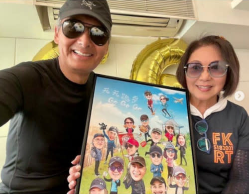 Fat Gor just recently turned 66 in May, here with Louise Lee who presented him with a very large birthday card from her and their jogging team