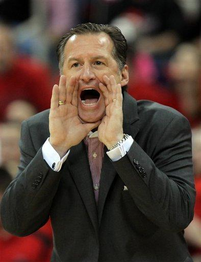 North Carolina State head coach Mark Gottfried directs his team during the first half of an NCAA college basketball game against North Carolina in Raleigh, N.C., Saturday, Jan. 26, 2013. N.C. State won 91-83. (AP Photo/Ted Richardson)