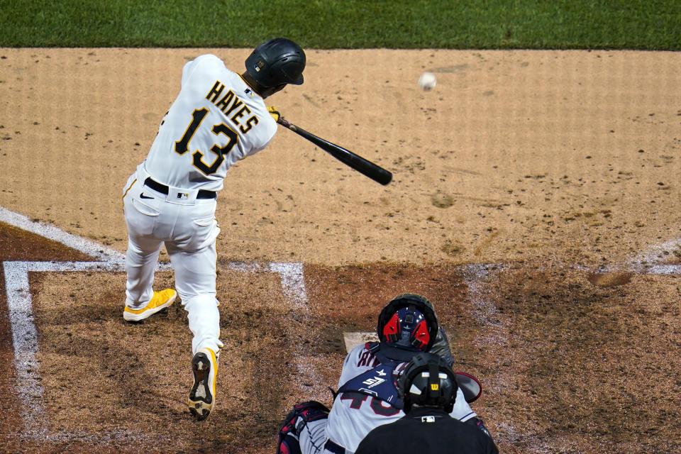 Pittsburgh Pirates' Ke'Bryan Hayes (13) hits a three-run double off Cleveland Indians relief pitcher Kyle Nelson during the sixth inning of a baseball game in Pittsburgh, Friday, June 18, 2021. (AP Photo/Gene J. Puskar)