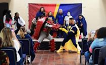 Captain Empathy, Chavez (R), fights the Covid-19 virus during the closing scene of a superhero-themed Covid-19 play on August 19
