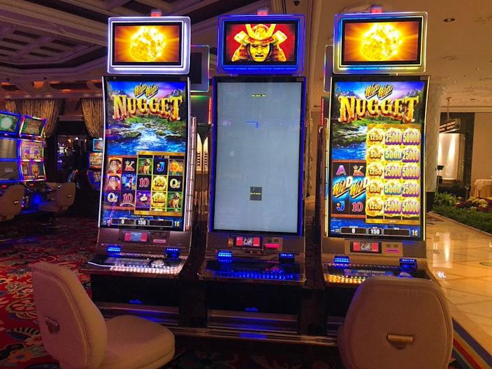 At the Wynn Las Vegas, slot machines are set up for social distancing with middle machines out of service to separate gamblers in the name of social distancing.