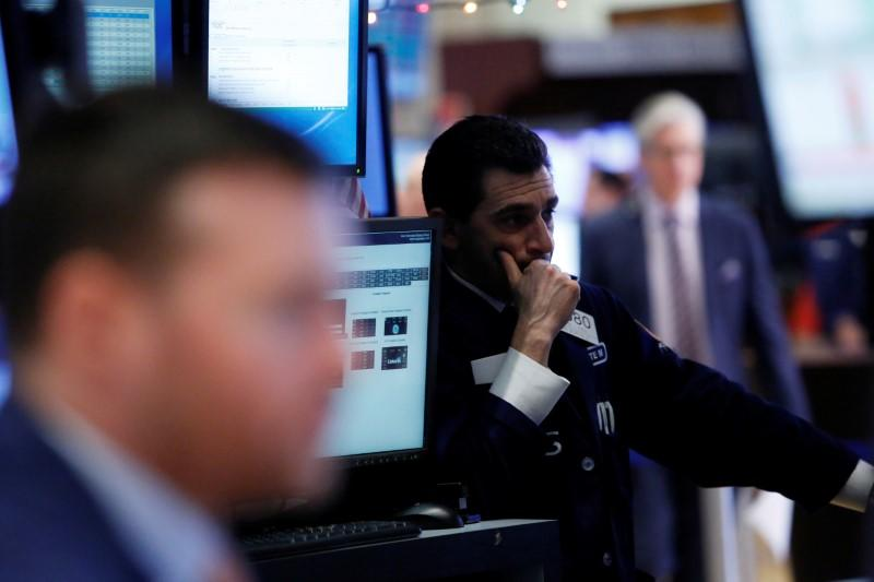 A trader works on the floor at the New York Stock Exchange (NYSE) in Manhattan