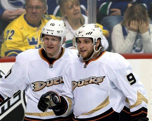 Anaheim Ducks' Corey Perry, left, and Bobby Ryan celebrate Perry's goal against the Vancouver Canucks during the second period of an NHL hockey game in Vancouver, British Columbia on Saturday, Jan. 19, 2013. (AP Photo/The Canadian Press, Darryl Dyck)