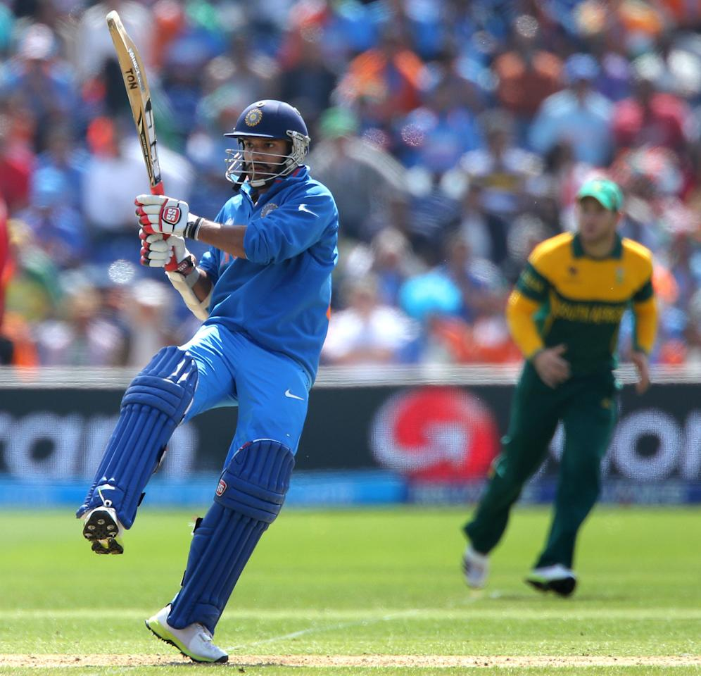 India's Shikhar Dhawan hooks the ball square during the ICC Champions Trophy match against South Africa, at the SWALEC Stadium, Cardiff.