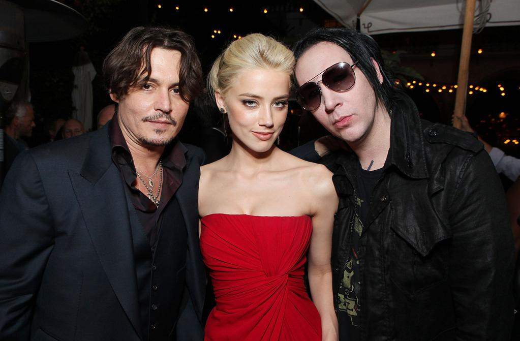 """<a href=""""http://movies.yahoo.com/movie/contributor/1800019485"""">Johnny Depp</a>, <a href=""""http://movies.yahoo.com/movie/contributor/1809059761"""">Amber Heard</a> and <a href=""""http://movies.yahoo.com/movie/contributor/1800303496"""">Marilyn Manson</a> at the Los Angeles premiere of <a href=""""http://movies.yahoo.com/movie/1810077951/info"""">The Rum Diary</a> on October 13, 2011."""