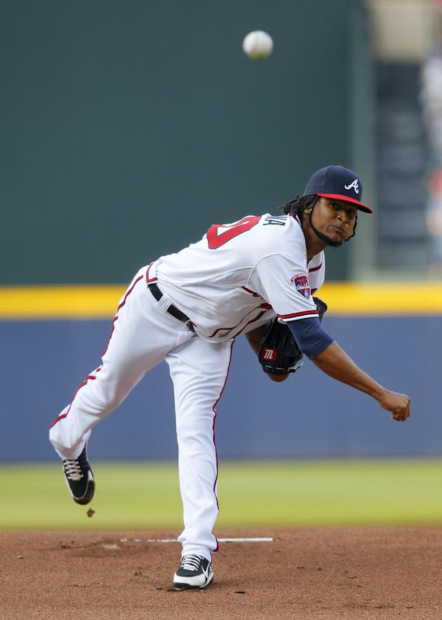 Atlanta Braves starting pitcher Ervin Santana delivers in the first inning of a baseball game against the Philadelphia Phillies Tuesday, June 17, 2014, in Atlanta. (AP Photo/Todd Kirkland)