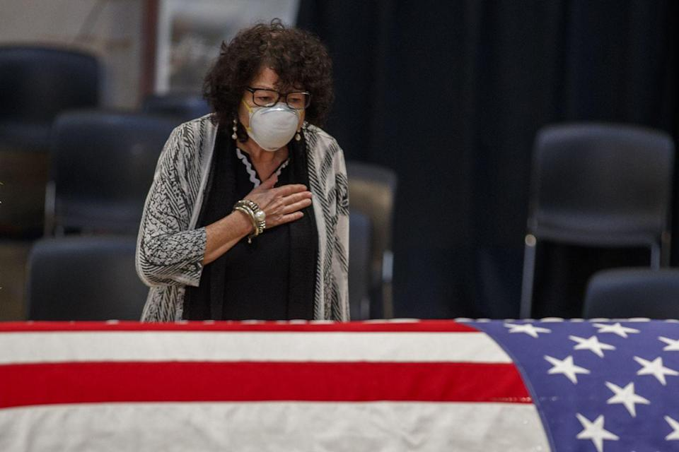 <p>Supreme Court Justice Sonia Sotomayor placed her hand over her heart while standing over Lewis's casket. </p>